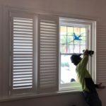 a-technician-install-plantation-shutters
